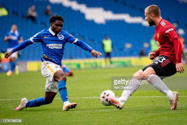 Luke Shaw of Manchester United in action with Tariq Lamptey of Brighton and Hove Albion during the Premier League match between Brighton & Hove...