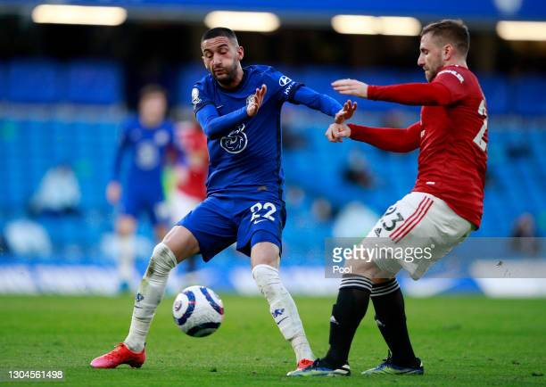 Luke Shaw of Manchester United is challenged by Hakim Ziyech of Chelsea during the Premier League match between Chelsea and Manchester United at...