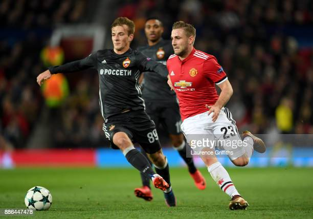 Luke Shaw of Manchester United is challenged by Konstantin Kuchaev of CSKA Moscow during the UEFA Champions League group A match between Manchester...