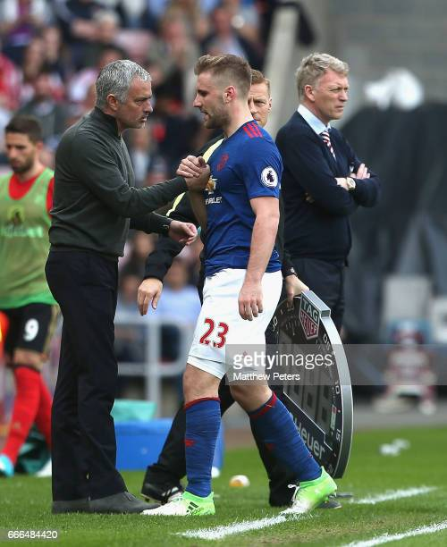 Luke Shaw of Manchester United is congratulated by Manager Jose Mourinho after being substituted during the Premier League match between Sunderland...