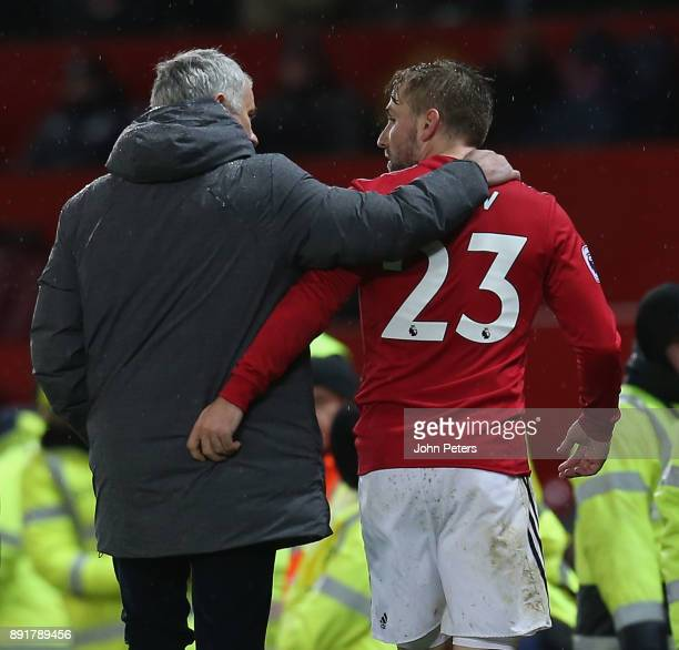 Luke Shaw of Manchester United is congratulated by Manager Jose Mourinho after being substituted during the Premier League match between Manchester...