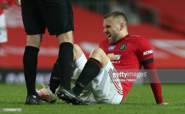 Luke Shaw of Manchester United lies injured during the Premier League match between Manchester United and Southampton FC at Old Trafford on July 13,...