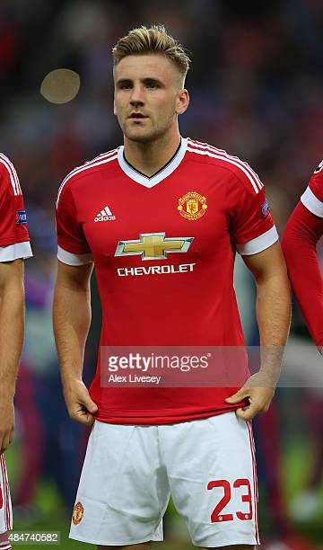 Luke Shaw of Manchester United lines up prior to the UEFA Champions League Qualifying Round Play Off First Leg match between Manchester United and...