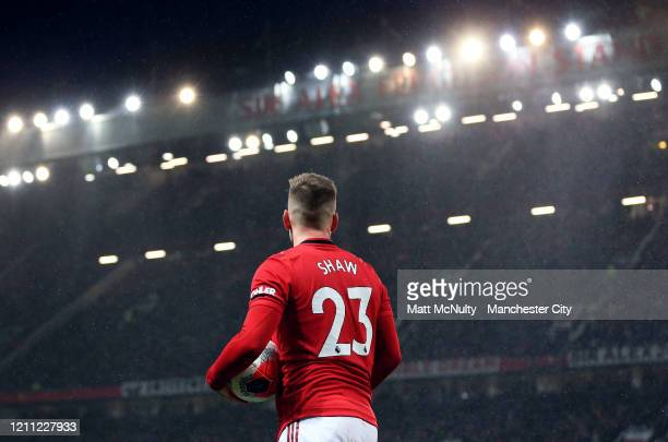 Luke Shaw of Manchester United prepares to take a throw in during the Premier League match between Manchester United and Manchester City at Old...
