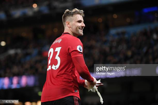 Luke Shaw of Manchester United reacts as he is substituted off during the Premier League match between Manchester City and Manchester United at...