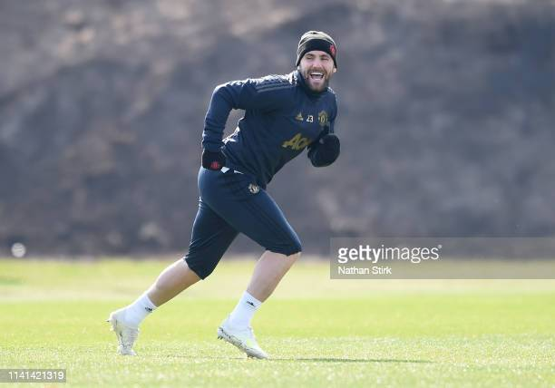 Luke Shaw of Manchester United reacts during the Manchester United training session ahead of the UEFA Champions League Quarter Final First Leg match...