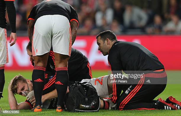 Luke Shaw of Manchester United receives treatment on a leg injury during the UEFA Champions League match between PSV Eindhoven and Manchester United...