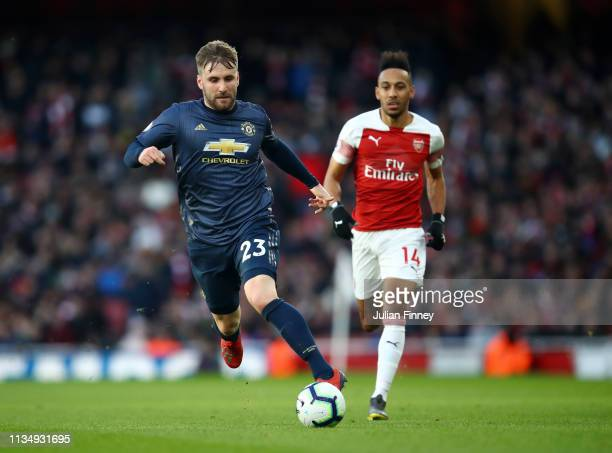 Luke Shaw of Manchester United runs with the ball during the Premier League match between Arsenal FC and Manchester United at Emirates Stadium on...
