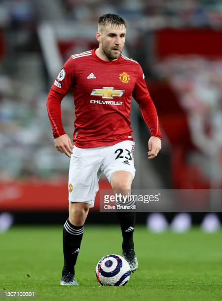 Luke Shaw of Manchester United runs with the ball during the Premier League match between Manchester United and West Ham United at Old Trafford on...