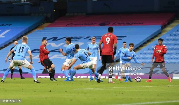 Luke Shaw of Manchester United scores the second goal during the Premier League match between Manchester City and Manchester United at the Etihad...