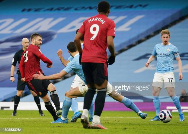 Luke Shaw of Manchester United scores their sides second goal during the Premier League match between Manchester City and Manchester United at Etihad...