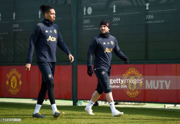 Luke Shaw of Manchester United speaks to Chris Smalling of Manchester United during the Manchester United training session ahead of the UEFA...