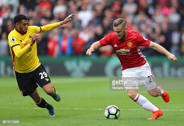 Luke Shaw of Manchester United takes the ball past Etienne Capoue of Watford during the Premier League match between Watford and Manchester United at...
