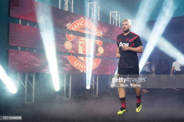 Luke Shaw of Manchester United walks out onto the pitch in front of the Manchester United logo during the International Champions Cup soccer match...