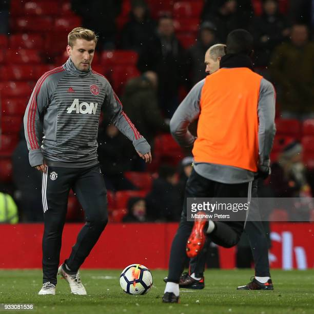 Luke Shaw of Manchester United warms up ahead of the Emirates FA Cup Quarter Final match between Manchester United and Brighton Hove Albion at Old...