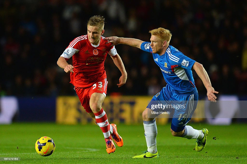 Luke Shaw of Southampton is challenged by Paul McShane of Hull City during the Barclays Premier League match between Southampton and Hull City at St Mary's Stadium on November 9, 2013 in Southampton, England.