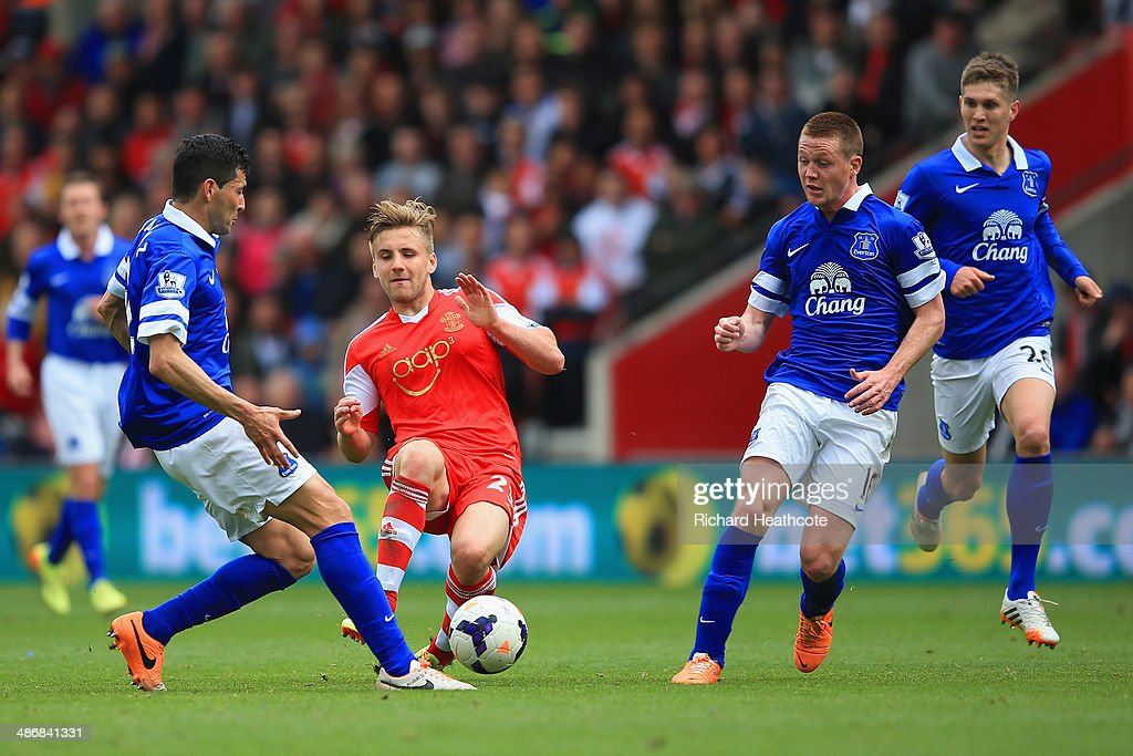 Luke Shaw of Southampton is closed down by Antolín Alcaraz and James McCarthy of Everton during the Barclays Premier League match between Southampton and Everton at St Mary's Stadium on April 26, 2014 in Southampton, England.