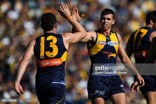 Luke Shuey and Jamie Cripps of the Eagles celebrates a goal during the 2017 AFL round 23 match between the West Coast Eagles and the Adelaide Crows...
