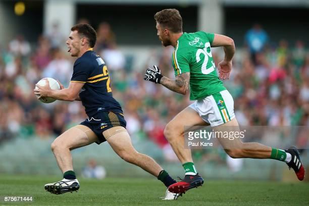 Luke Shuey of Australia runs the ball during game two of the International Rules Series between Australia and Ireland at Domain Stadium on November...