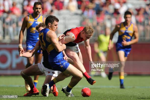 Luke Shuey of the Eagles and Clayton Oliver of the Demons contest for the ball during the AFL Preliminary Final match between the West Coast Eagles...