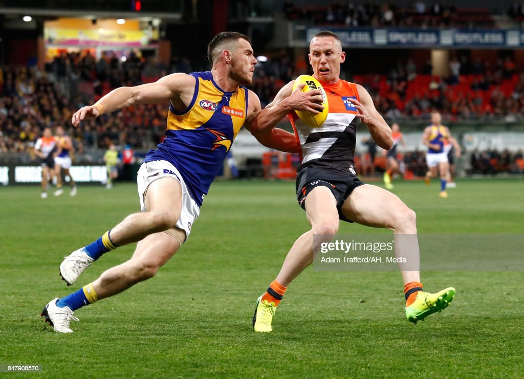 Luke Shuey of the Eagles and Tom Scully of the Giants compete for the ball during the 2017 AFL First Semi Final match between the GWS Giants and the West Coast Eagles at Spotless Stadium on September 16, 2017 in Sydney, Australia.