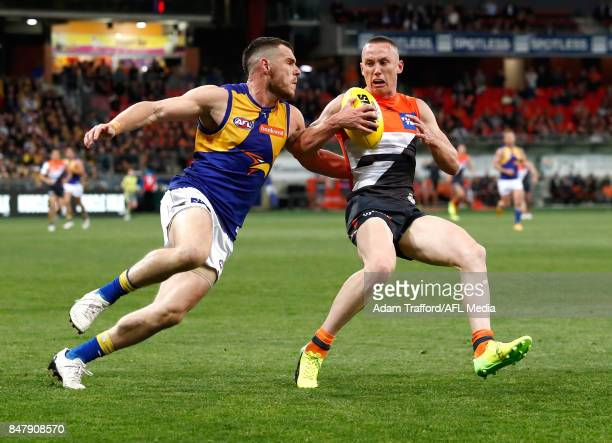 Luke Shuey of the Eagles and Tom Scully of the Giants compete for the ball during the 2017 AFL First Semi Final match between the GWS Giants and the...