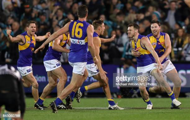 Luke Shuey of the Eagles celebrates kicking the winning goal with team mates during the AFL First Elimination Final match between Port Adelaide Power...