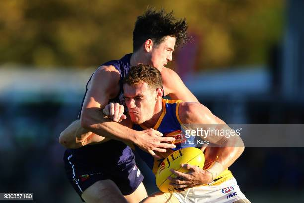 Luke Shuey of the Eagles gets tackled by Andrew Brayshaw of the Dockers during the JLT Community Series AFL match between the Fremantle Dockers and...