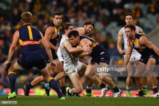 Luke Shuey of the Eagles gets tackled by Bryce Gibbs of the Blues during the round 21 AFL match between the West Coast Eagles and the Carlton Blues...