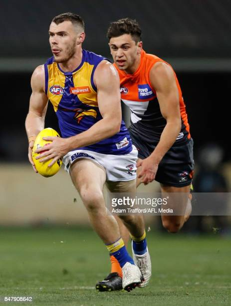 Luke Shuey of the Eagles in action ahead of Tim Taranto of the Giants during the 2017 AFL First Semi Final match between the GWS Giants and the West...