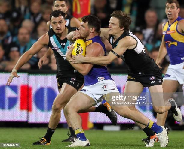 Luke Shuey of the Eagles is tackled by Jared Polec of the Power illegally before kicking the winning goal during the AFL First Elimination Final...