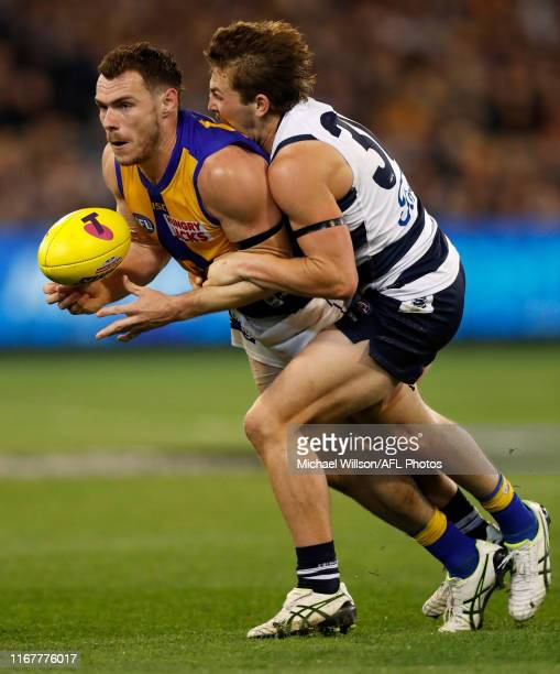 Luke Shuey of the Eagles is tackled by Tom Atkins of the Cats during the 2019 AFL First Semi Final match between the Geelong Cats and the West Coast...