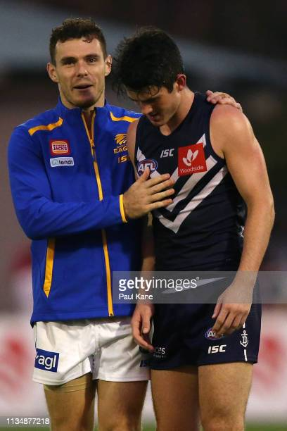 Luke Shuey of the Eagles shares a moment with Andrew Brayshaw of the Docker following the 2019 JLT Community Series AFL match between the Fremantle...