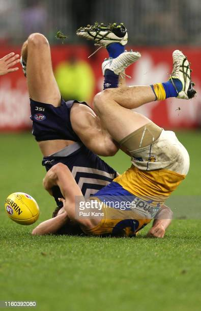 Luke Shuey of the Eagles tackles Darcy Tucker of the Dockers during the round 16 AFL match between the Fremantle Dockers and the West Coast Eagles at...