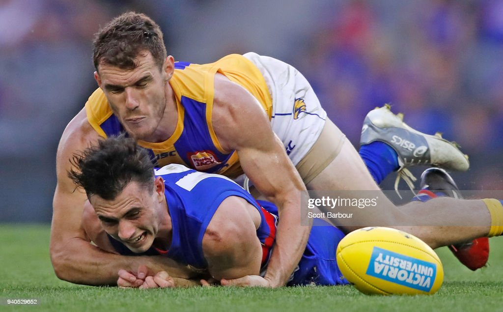 Luke Shuey of the Eagles tackles Toby McLean of the Bulldogs during the round two AFL match between the Western Bulldogs and the West Coast Eagles at Etihad Stadium on April 1, 2018 in Melbourne, Australia.