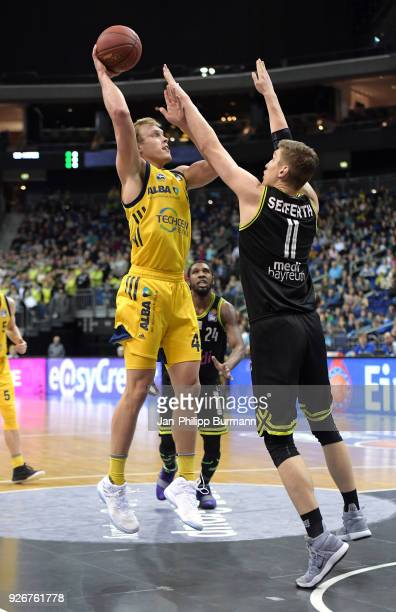 Luke Sikma of Alba Berlin and Andreas Seiferth of medi Bayreuth during the easyCredit BBL game between Alba Berlin and medi Bayreuth at MercedesBenz...