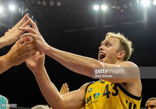 Luke Sikma of ALBA Berlin celebrates after winning the fourth playoff game of the German Basketball Bundesliga finals at MercedesBenz Arena on June...