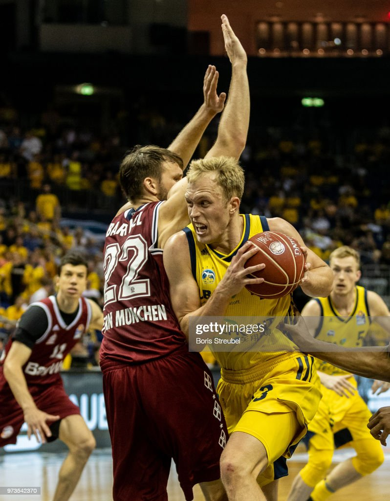 Luke Sikma of ALBA Berlin competes with Danilo Barthel of Bayern Muenchen during the fourth play-off game of the German Basketball Bundesliga finals at Mercedes-Benz Arena on June 13, 2018 in Berlin, Germany.
