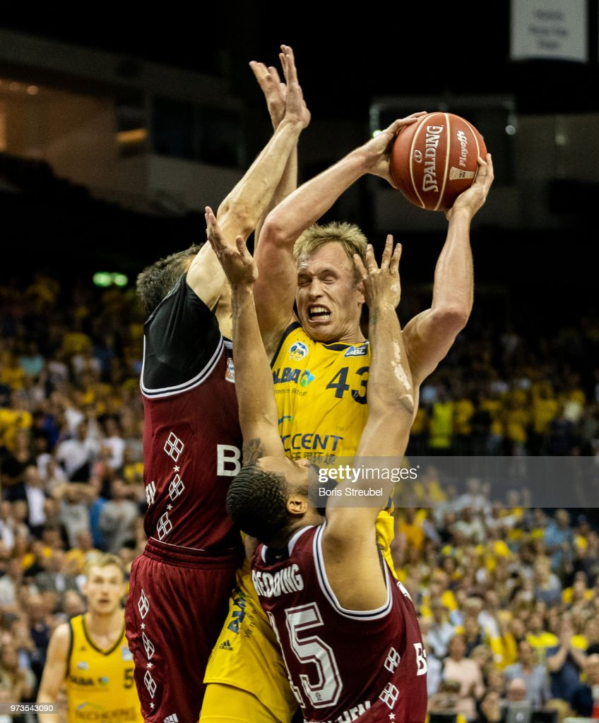 Luke Sikma of ALBA Berlin competes with Reggie Redding of Bayern Muenchen during the fourth play-off game of the German Basketball Bundesliga finals at Mercedes-Benz Arena on June 13, 2018 in Berlin, Germany.