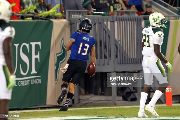 Luke Skipper of Tulsa carries the ball into the end zone for the score during the first half of the game between the Tulsa Golden Hurricane and the...