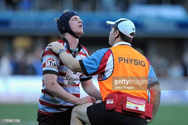 Luke Smart receives treatment from a physio during the round 16 Shute Shield match between Sydney Uni and Southern Districts at North Sydney Oval on...