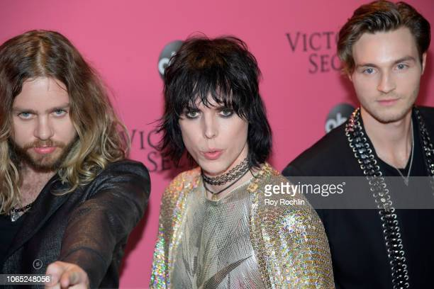 Luke Spiller Adam Slack Jed Elliott of The Struts attend the 2018 Victoria's Secret Fashion Show at Pier 94 on November 08 2018 in New York City