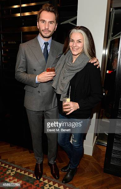 Luke Sweeney and Catherine Hayward attend the opening of the new Thom Sweeney RTW & MTM Store on November 13, 2014 in London, England.