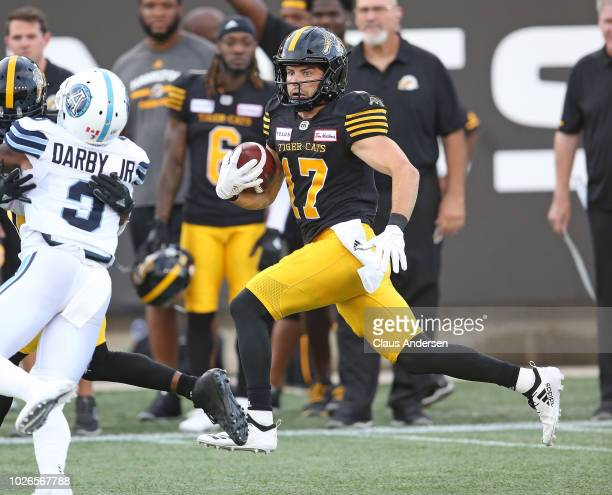 Luke Tasker of the Hamilton TigerCats runs a touchdown in against the Toronto Argonauts in a CFL game at Tim Hortons Field on September 3 2018 in...