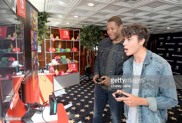 Luke Tennie and Benjamin Wadsworth test their skills on Super Smash Bros Ultimate for Nintendo Switch at the Variety Studio at ComicCon 2018 on July...