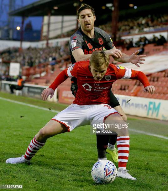 Luke Thomas of Barnsley in action with Stephen Ward of Stoke City during the Sky Bet Championship match between Barnsley and Stoke City at Oakwell...