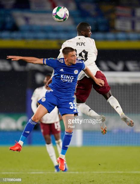Luke Thomas of Leicester City battles for possession with Nicolas Pepe of Arsenal during the Carabao Cup third round match between Leicester City and...