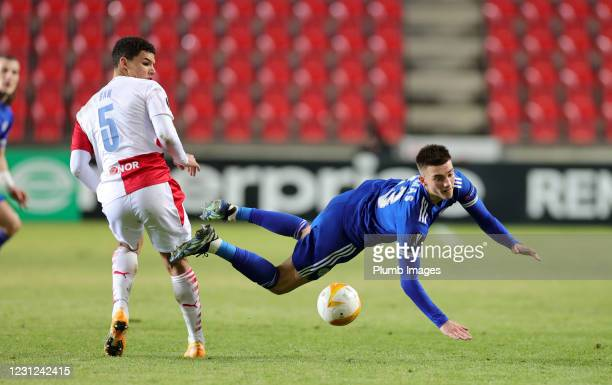 Luke Thomas of Leicester City is brought down by Alexander Bah of Slavia Prague during the UEFA Europa League Round of 32 match between Slavia Prague...