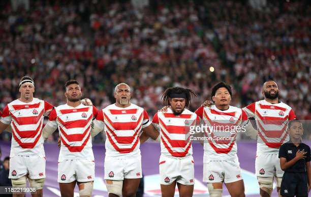 Luke Thompson, Amanaki Mafi, Isileli Nakajima, Shota Horie, Keita Inagaki and Michael Leitch of Japan line up for the national anthem prior to the...