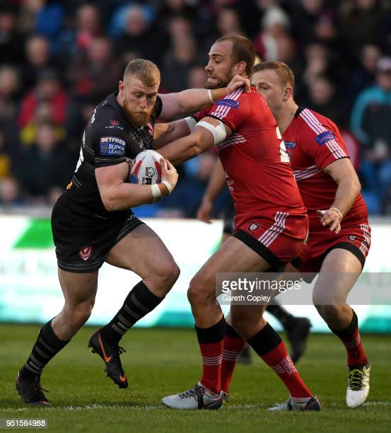 Luke Thompson of St Helens is tackled by Lee Mossop of Salford during the Betfred Super League match between Salford Red Devils and St Helens at AJ...